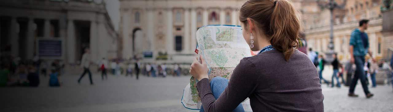 woman reading map